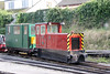 Talyllyn Railway Baguley Drewry (3779/1923) 4wDM No.12 'St Cadfan' with brakevan no.70 at Tywyn Pendre on 9th September 2017.