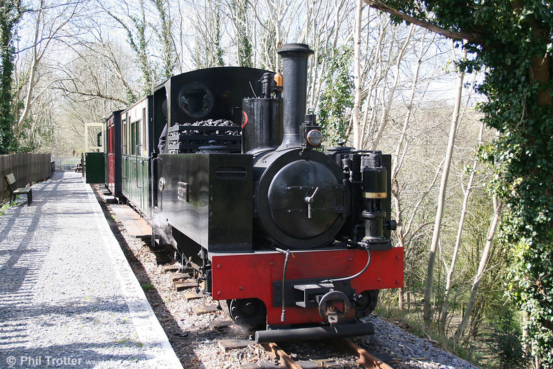 The Teifi Valley Railway's Kerr Stuart 0-6-2T 'Sgt. Murphy' waits to leave Llandyfriog for Henllan on 5th April 2008. The line is built on the trackbed of the former Pencader to Newcastle Emlyn branch which closed in 1973. The disused trackbed towards Newcastle Emlyn continues in the background but is separated from the TVR by a collapsed river bridge.