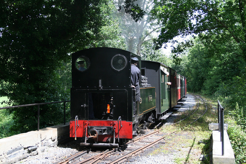Kerr Stuart (3117/1918) 0-6-2T 'Sgt. Murphy' shunts its train at Llandyfriog before running around and returning to Henllan on 17th July 2010.