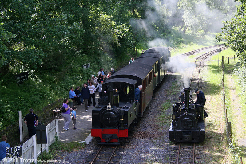 A busy scene at Henllan, Teifi Valley Railway on 20th July 2008. Kerr, Stuart 0-6-2ST 'Sgt. Murphy' has arrived with the 1410 from Llandyfriog, while Hunslet 0-4-0ST 'Alan George' waits to take over the 1440 departure.