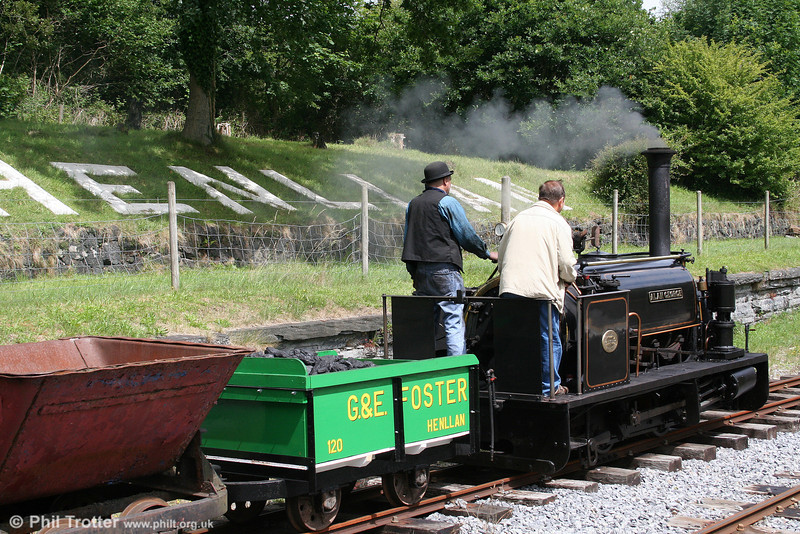 Quarry Hunslet 0-4-0ST (HE606/1894) 'Alan George' passes with its demonstration train of tippler wagons on 17th July 2010.