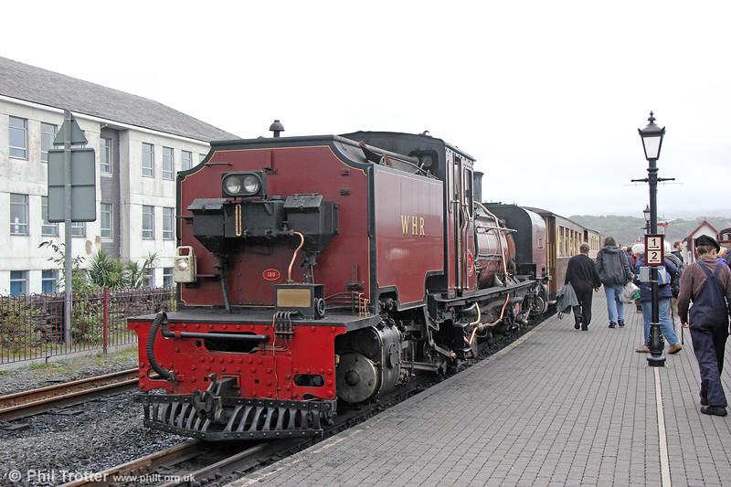 Welsh Highland Railway  NGG16 2-6-2+2-6-2T Garratt no. 138 (BP 7863/1958) rosses the A497 at Porthmadog, ready to return to Caernarfon at 1540 on 7th September 2017.