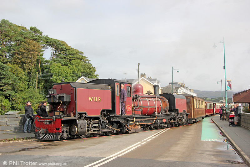 Welsh Highland Railway  NGG16 2-6-2+2-6-2T Garratt no. 138 (BP 7863/1958) crosses the A497 at Porthmadog with the 1545 to Caernarfon on 5th September 2017.