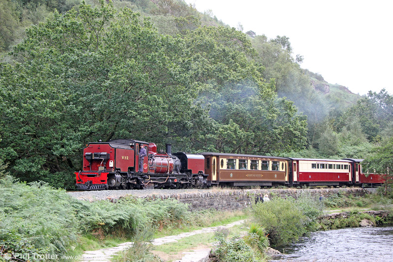 Welsh Highland Railway  NGG16 2-6-2+2-6-2T Garratt no. 138 (BP 7863/1958) alongside the Afon Glaslyn near Beddgelert with the 1050 from Porthmadog on 17th August 2018.