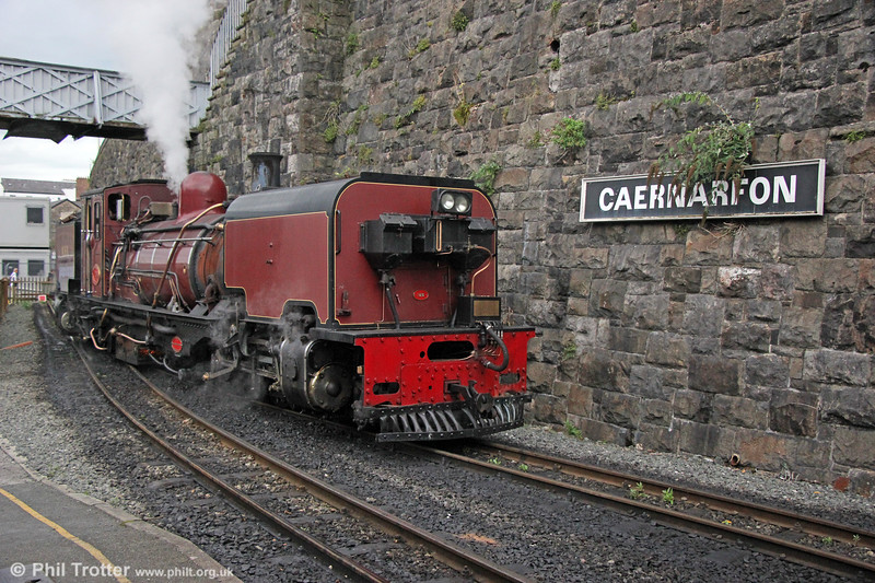 Welsh Highland Railway  NGG16 2-6-2+2-6-2T Garratt no. 138 (BP 7863/1958) at Caernarfon on 7th September 2017.  This loco was one of the fourth batch of seven NGG16s (nos 137 - 143) built in 1958. These were the last steam locos built by Beyer Peacock, which were originally ordered by the Tsumeb Copper Corp of South West Africa in 1958 but when its line was altered to Cape Gauge, South African Railways took over the order.<br /> At the time of the visit a new more substantial station building was under construction beyond the current headshunt.