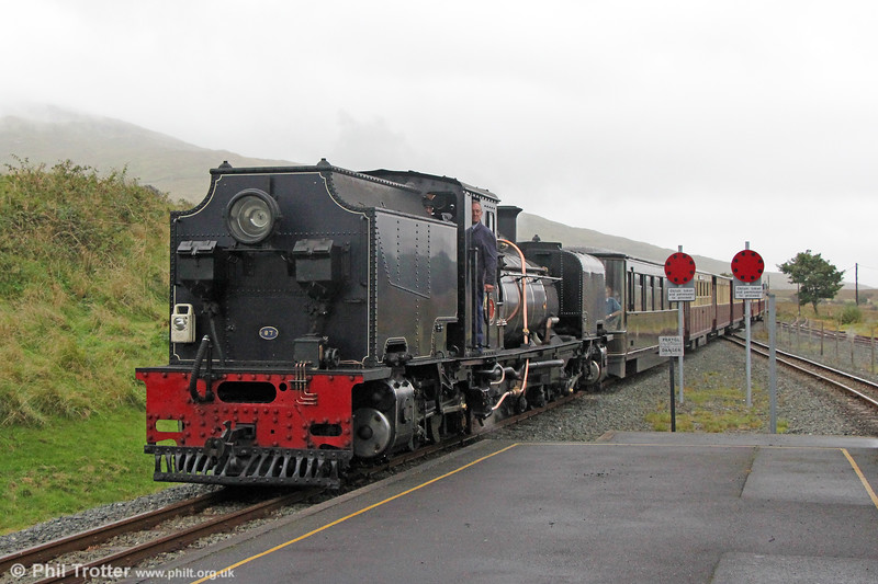 Welsh Highland Railway  NGG16 2-6-2+2-6-2T Garratt no. 87 (Cockerill 3267/1936) pulls into Rhyd Ddu with the 1255 from Porthmadog to Caernarfon on 7th September 2017.