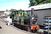 Welshpool & Llanfair 0-6-0T 823 'Countess' simmers while taking water in the sunshine at Llanfair Caereinion before heading a train back to Welshpool on 21st August 2005.