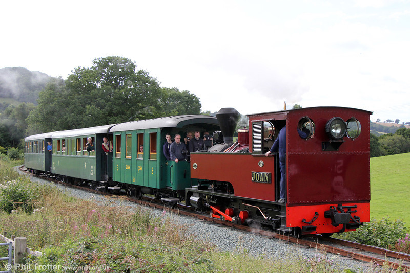 The cosmopolitan nature of the Welshpool & Llanfair Light Railway is underlined in this view. W&LLR Kerr Stuart (4404/1927) 0-6-2T no. 12 'Joan' (which worked in Antigua) passes Coppice Lane with the 1510 Llanfair Caereinion to Welshpool on 31st August 2013. The leading coach is a four-wheeler built in Graz in 1925 as number Ci569 for the Salzkammergut Localbahn in Austria, while the two bogie coaches (418 and 430) were built for MAV, the Hungarian State Railway.