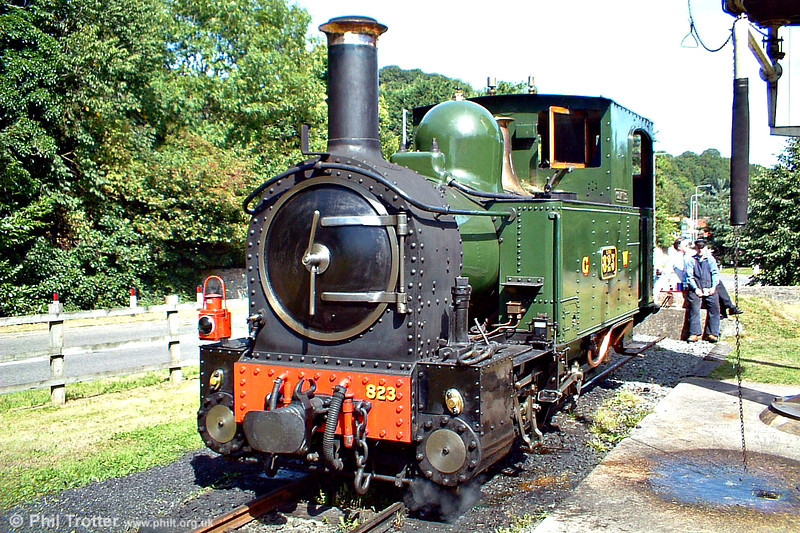 The crew of Welshpool & Llanfair no. 823 'Countess' relax in the sunshine at Welshpool, Raven Square on 21st August 2005.