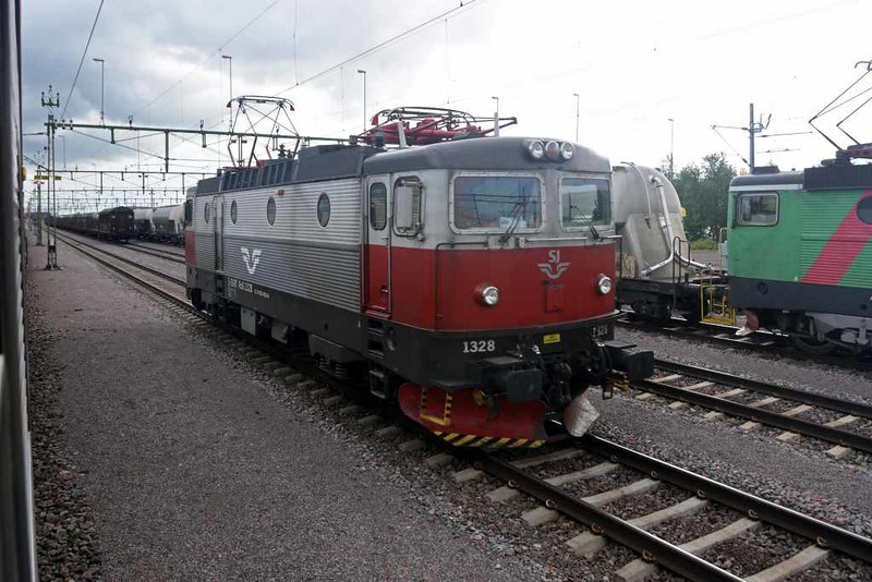Swedish Railways (SJ) Rc6 No 1328, Kiruna Central, Sweden, Fri 24 July 2015 - 1546.  Running round the 1240 Narvik - Stockholm / Lulea, which now reverses here.  The railway used to continue directly south from Kiruna, but has been realigned and now runs round the western side of Lake Luossajarvi.  Kiruna is 169km from Narvik and 1413km from Stockholm.