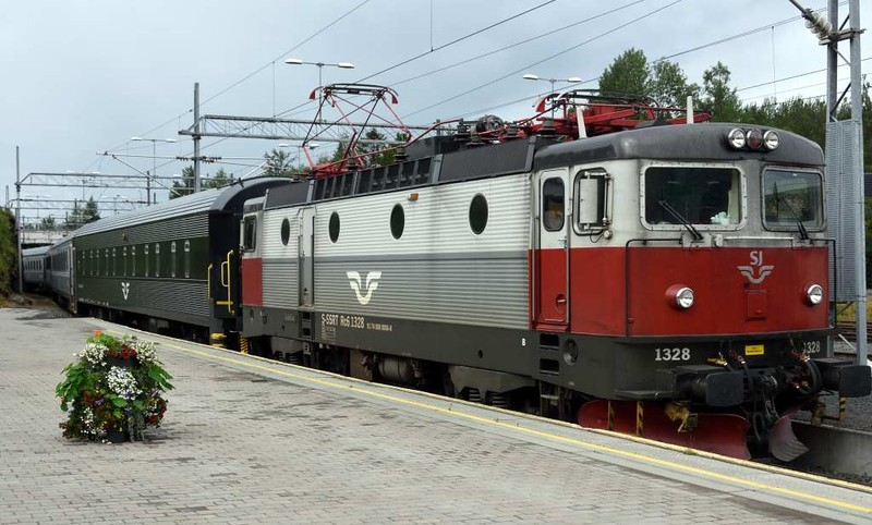 Swedish Railways (SJ) Rc6 No 1328, Narvik, Fri 24 July 2015 - 1210.  Arriving with the stock for the 1240 to Lulea and Stockholm.  There were 10 coaches.  The train divided at Boden, and the front portion continued to the Baltic port of Lulea,