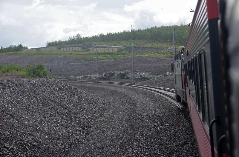 Swedish Railways (SJ) Rc6 No 1328, near Kiruna iron ore mine, Sweden, Fri 24 July 2015 - 1606.  This is the new alignment around Lake Luossajarvi.