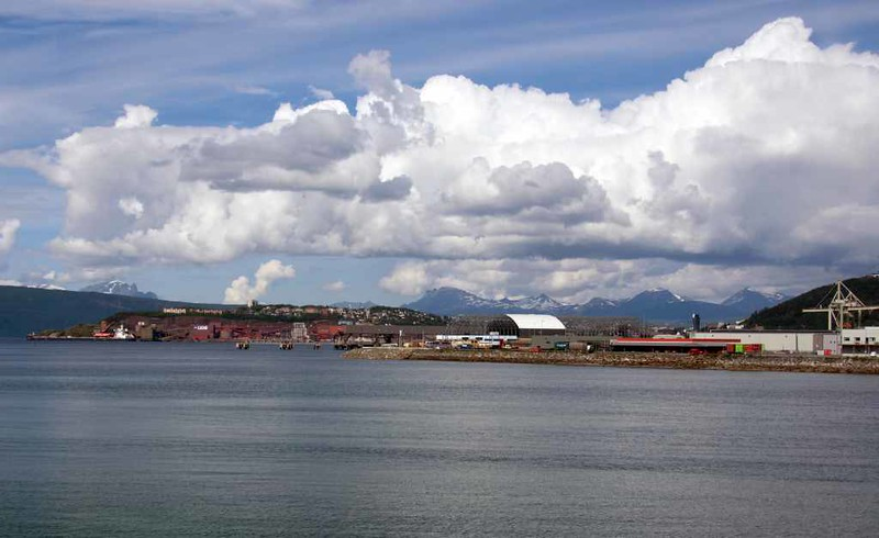 Narvik 23 July 2015.  Looking north to the port from the E6 road.  A Chinese bulk carrier, Qing May, can be seen at left loading iron ore.