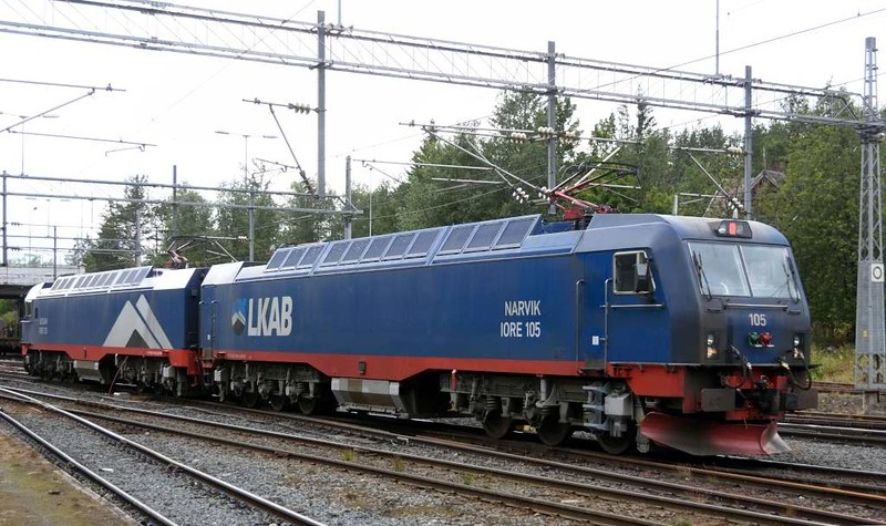 LKAB 105 Narvik & 125 Sjisjka, Narvik station, 23 July 2015 - 1711.  One of the 17 10,800kW class IORE twin locos built by Bombardier 2000 - 2014 for the Luossavaara - Kirunavaara AB (LKAB) iron ore mining company.  Norwegian and Swedish railways including the Kiruna - Narvik line are electrified at 15kV 16.7Hz AC.