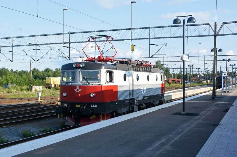 Swedish Railways (SJ) Rc6 No 1331, Boden Central, Sweden, Fri 24 July 2015 - 1919.  Waiting to attach to the rear of the 1240 sleeper from Narvik and haul it to Stockholm.  The front section continued to the Baltic port of Lulea,  Boden is 437km from Narvik and 1145km from Stockholm.