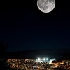 Måne over Narvik. Montasje av fullmåne 9. februar 2012 og deler av Narvik by, der månen er montert inn i himmelen.<br /> Moon over Narvik. Full moon 9th of January. The moon and the town is shot the same day, but in different directions and with different lenses. The full moon is then mounted into the dark sky over the town.