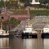 Slepebåtene Svarta Bjørn, Rombak og Rallaren. I bakgrunnen restene av den gamle høybanen. Noen få søyler står igjen.