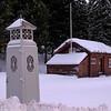 """Narviks første postkontor, og en """"trafokiosk"""" - begge museale gjenstander i dag. 3. juledag 2014. Snevær på natta. Mørketid og en julestille by."""