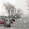 """E6-Kongens gate Narvik 14. mars 2014. Tippet søppelcontainer og folketomt midt på dagen. Ekstremværet """"Kyrre"""" kommer med vind og snø. Som vanlig gikk det pent for seg innerst i Ofotfjorden."""