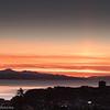 Solnedgang med deler av Narvik i forgunnen.