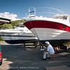 """Båtpuss Ankenes småbåthavn. Kurt Mathisen bunnsmører familiens 36 """" båt. 4. juli 2011."""