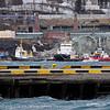 Høy flo pga fullmåne og pålandsvind. Slepebåter bak. Til venstre Svarta Bjørn, midt på Rombak og til høyre Western Seoi?  Narvik havn 20.3.2011