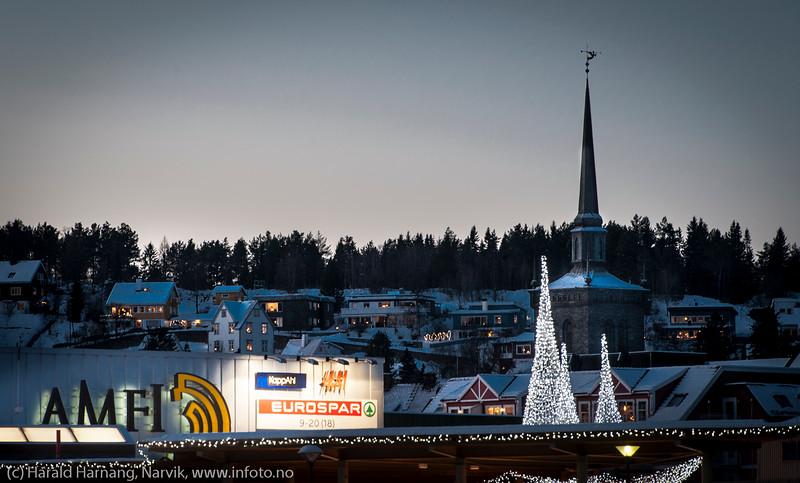 Kamp om sjeler: Gud eller Mammon :-) Vet ikke om det hjelper å ha høyst tårn engang. Narvik 22. desember 2014.