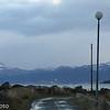 Bjerkvik i bakgrunnen. I forgrunnen moloen ved småbåthavna i Vassvik.