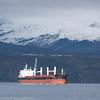Malmskip venter på last, mellom Narvik og Trollhøgda. Bak campingvogner. Skip: Puerto Rosario, Singapore. Gross Tonnage:  36353<br /> Deadweight:  64689 t<br /> Length Overall x Breadth Extreme:  199.9m × 32.32m<br /> Year Built:  2014