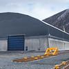 Lasteanlegget til tidligere Northland Ressourses, nå kjøpt av Narvik havn. Lagerbygget som fikk store skader (bl.a. ble taket totalskadd) under stormene i januar 2015 er reparert. Foto 15. april 2016.