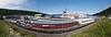 Fagernesterminalen. Noen av bygningene i forgrunnen skal rives for å gi plass til flere spor. Bak cruiseskip: AIDAaura: Flag:  Italy [IT]. AIS Vessel Type:  Passenger. Gross Tonnage:  42289. Deadweight:  4157 t, Length Overall x Breadth Extreme:  202.85m × 28.1m. Year Built:  2003. Foto 7. juli 2019. Panorama satt sammen av flere enkeltbilder.