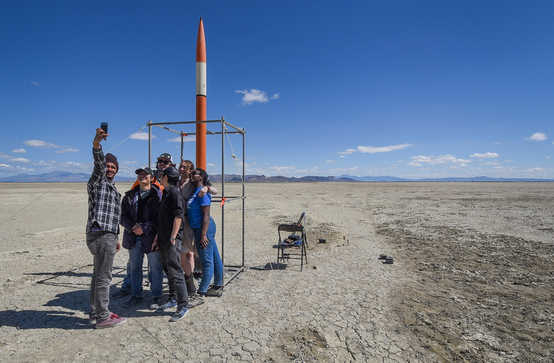Students from Seattle Central College take a selfie with their rocket before they launch it in Black Rock Desert, Nev. on May 1, 2016.