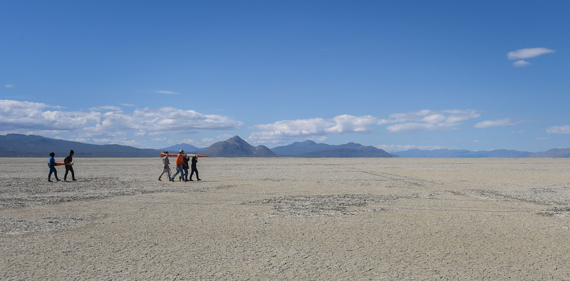 Students from Seattle Central College walk across the playa to set up their rocket to launch in Black Rock Desert, Nev. on May 1, 2016.