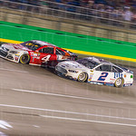 Battle of the beer wagons: Brad Keselowski drove his Miller Lite-backed Ford to the inside of the Budweiser-sponsored Chevy piloted by Kevin Harvick.