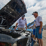 Steve Chaney, left, answered questions about his 1967 Mustang for Homer Berry. Chaney\'s Mustang was part of a classic car display that fans could enjoy during the day.