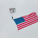 Old Glory was delivered to the track via skydiver.