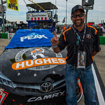 Hughes General Contractors adorned the hood of Clint Bowyer\'s #15 Michael Waltrip Racing Toyota. Company president Scott Hughes was very excited to see his company\'s name on the car.