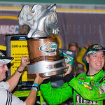 Kyle Busch, who won the inaugural Quaker State 400 at Kentucky Speedway in 2011, hoisted the trophy following the 2015 event.