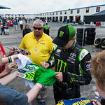 On his way to the Xfinity series drivers meeting, Kyle Busch stopped to sign a few autographs.