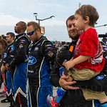 Houston Stamper, front tire changer for Chris Buescher\'s Xfinity Series #60 Ford team, held son Liam during the invocation and national anthem.