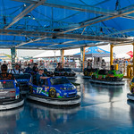 Families enjoyed the Fan Zone set up inside the pit area, especially the bumper cars decorated like their favorite drivers\' race cars.
