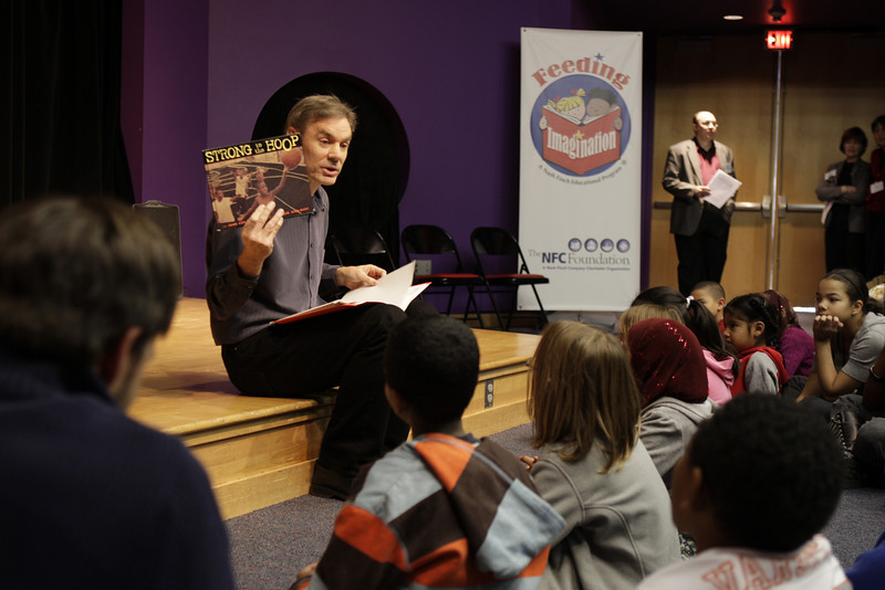 Minneapolis, MN - Children's book author, John Coy, spoke to local school children who took part in the Feeding Imagination Celebration honoring the 2nd year of books donated to local schools and organizations by the Nash Finch Company Charitable Foundation here today, Thursday November 20, 2008. The Feeding Imagination program has donated over 60,000 books to local organizations in the last 2 years and announced 12,000 more books to be donated to 12 organizations today. Date: Thursday November 20, 2008 Photo by © Todd Buchanan 2008 Technical Questions: todd@toddbuchanan.com; Phone: 612-226-5154.