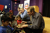 Minneapolis, MN - Children's book author, John Coy, autographed his latest boo after he spoke to local school children who took part in the Feeding Imagination Celebration honoring the 2nd year of books donated to local schools and organizations by the Nash Finch Company Charitable Foundation here today, Thursday November 20, 2008. The Feeding Imagination program has donated over 60,000 books to local organizations in the last 2 years and announced 12,000 more books to be donated to 12 organizations today. Date: Thursday November 20, 2008 Photo by © Todd Buchanan 2008 Technical Questions: todd@toddbuchanan.com; Phone: 612-226-5154.