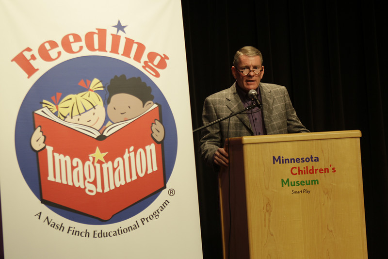 Minneapolis, MN - Alec Covington, CEO of Nash Finch, addresses local school children who took part in the Feeding Imagination Celebration honoring the 2nd year of books donated to local schools and organizations by the Nash Finch Company Charitable Foundation here today, Thursday November 20, 2008. The Feeding Imagination program has donated over 60,000 books to local organizations in the last 2 years and announced 12,000 more books to be donated to 12 organizations today. Date: Thursday November 20, 2008 Photo by © Todd Buchanan 2008 Technical Questions: todd@toddbuchanan.com; Phone: 612-226-5154.