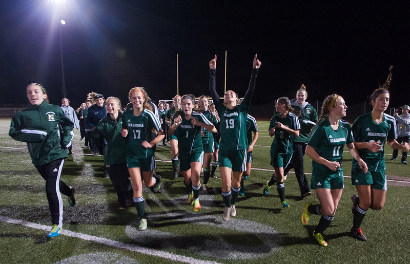 The Nashoba Chieftains come off the field celebrating after beating West Springfield 1-0 in the State Div I Semi-Final. SENTINEL & ENTERPRISE / Jim Marabello