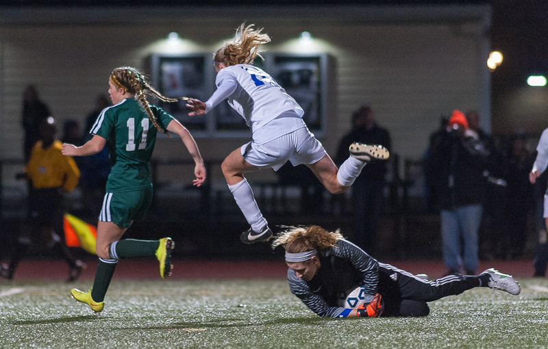 W. Springfield Keeper Jaimee O'Brien comes way out of her net to stop a drive by Nashoba's Madison Conway. SENTINEL & ENTERPRISE / JIM MARABELLO