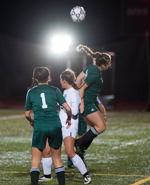 The glitter flies as Danielle Scafidi heads a ball away from W. Springfield in the Div I Semi-Final. The Chieftains won 1-0 to move on to the State Championship game. SENTINEL&ENTERPRISE/ Jim Marabello