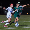 Nashoba's Sarah Gillooly battles W. Springfield's Hailey MacDonald in the State Div I Semi-FInal which the Chieftains won 1-0. SENTINEL & ENTERPRISE / JIM MARABELLO