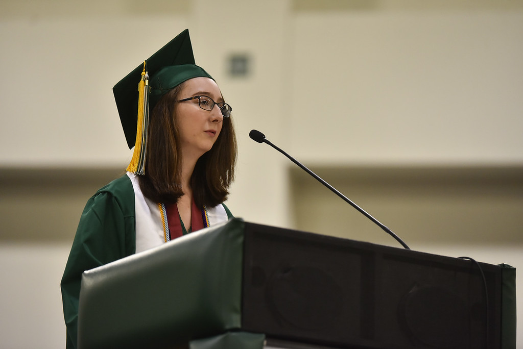 . Class salutatorian Hannah Castner takes to the podium to address graduates at the DCU Center in Worcester for the Nashoba Regional commencement ceremonies on Sunday.  SENTINEL & ENTERPRISE JEFF PORTER