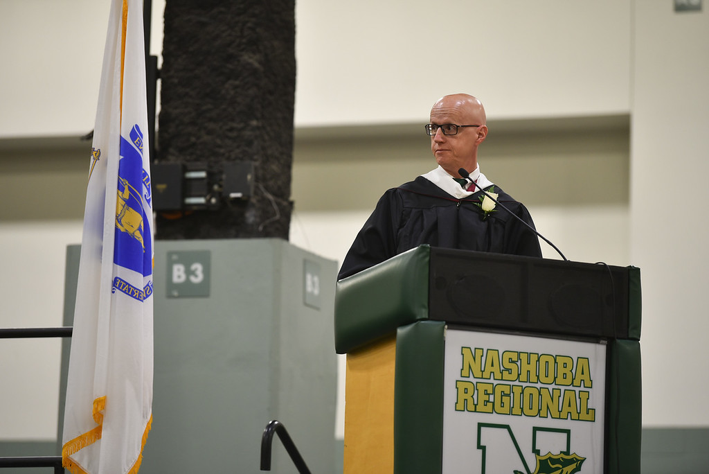 . Nashoba Regional principal Paul Di Domenico speaks at the DCU Center in Worcester for the Nashoba Regional commencement ceremonies on Sunday.  SENTINEL & ENTERPRISE JEFF PORTER